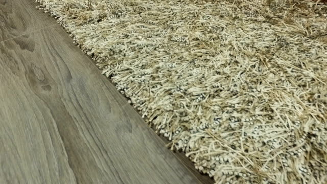 synthetic carpet on the laminate in the home interior. close-up - lanuginoso video stock e b–roll