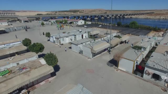 Syrian refugee camp in Gaziantep, Turkey 11/16/2017 General drone images from syrian refugees camp near the dam. Gaziantep/TURKEY 11/16/2017 syria stock videos & royalty-free footage