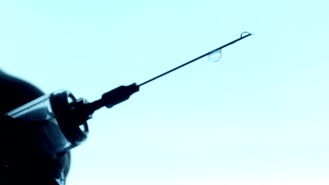 syringe needle vaccine dripping close up - doping stok videoları ve detay görüntü çekimi