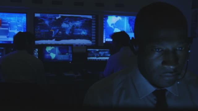 system control room monitoring - orta plan plan türleri stok videoları ve detay görüntü çekimi