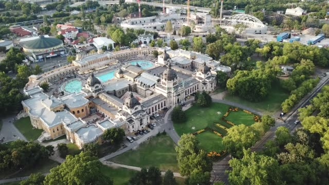 Széchenyi Medicinal Bath in Budapest, Hungary An aerial view of Szechenyi Spa Baths located in City Park (Városliget), Budapest, Hungary. It is one of the best and largest spa baths in Europe with its 15 indoor baths and 3 grand outdoor pools. hungary stock videos & royalty-free footage