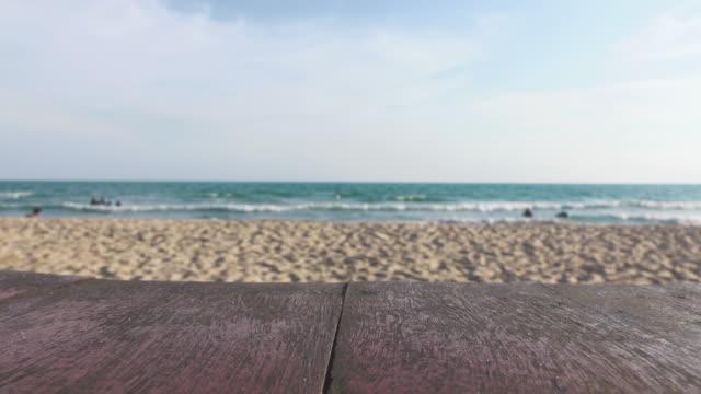table and beach - tavolo legno video stock e b–roll