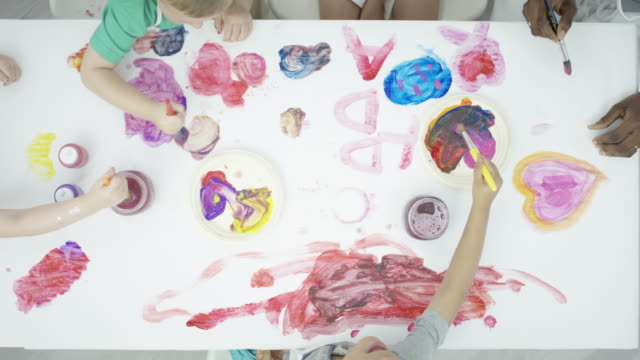 Table Covered in Paintings from Children video