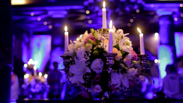 Table decoration with candles and flowers video