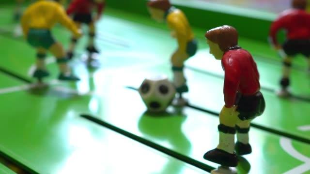 table football, children's board game, slow motion - campionato video stock e b–roll