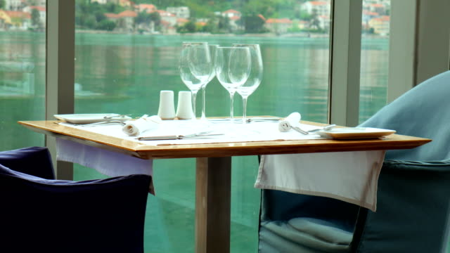 a table in restaurant near the sea, kotor, montenegro - средиземноморская культура стоковые видео и кадры b-roll