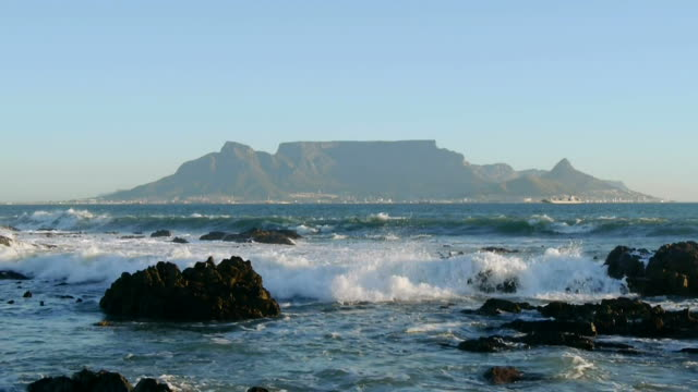 table mountain in cape town, south africa view across the ocean to landmark of table mountain, in cape town, south africa cape peninsula stock videos & royalty-free footage