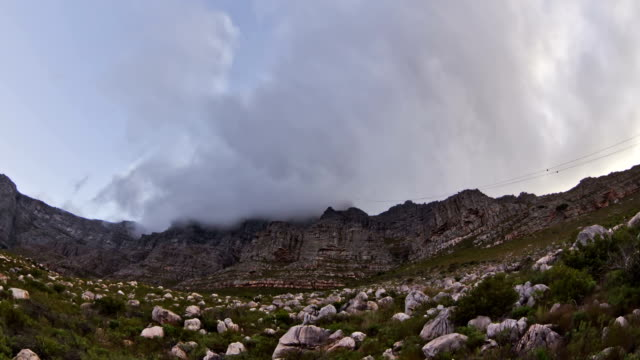 Table Mountain Time Lapse Clouds Evening v5. Beautiful time lapse clip of cloud cover passing over Table Mountain in South Africa. cape peninsula stock videos & royalty-free footage