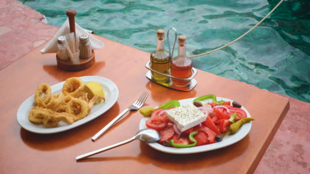 table with food in Greek restaurant on beach