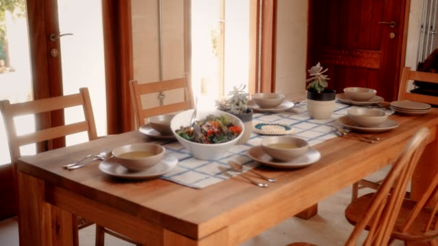 Table with healthy meal served at home for family lunch