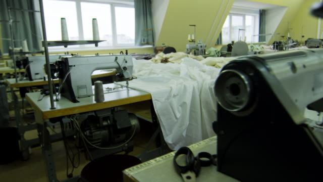 Tables with Sewing Equipment at Empty Factory