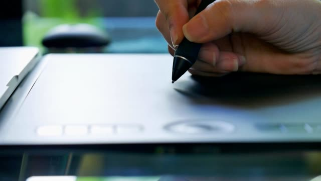 tablet and pen . - designers video stock e b–roll