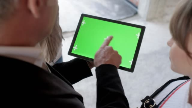ipad tablet green screen held by businessman in construction site - business people stock videos and b-roll footage