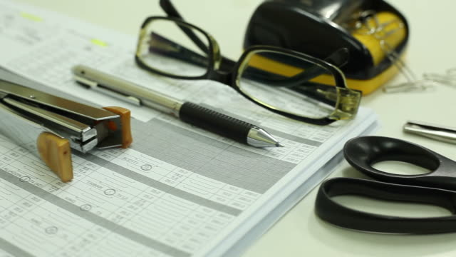 Tablet, glasses, papers, pen and accessory on white background video