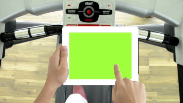 Tablet green screen and running machines video