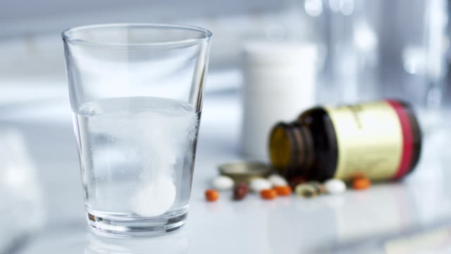 Tablet of Aspirin Dissolving in Glass of Water video