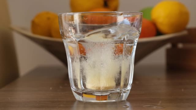 Tablet of vitamin C dissolves in water