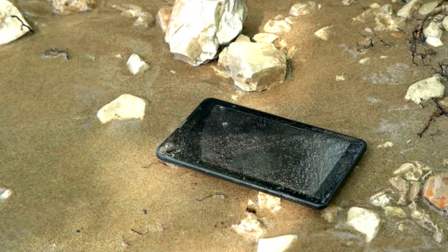 A tablet on the banks of the river is washed by the wave A tablet on the banks of the river is washed by the wave HD durability stock videos & royalty-free footage