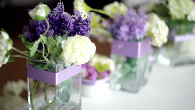tableware and decor of bouquets of flowers for the wedding party video