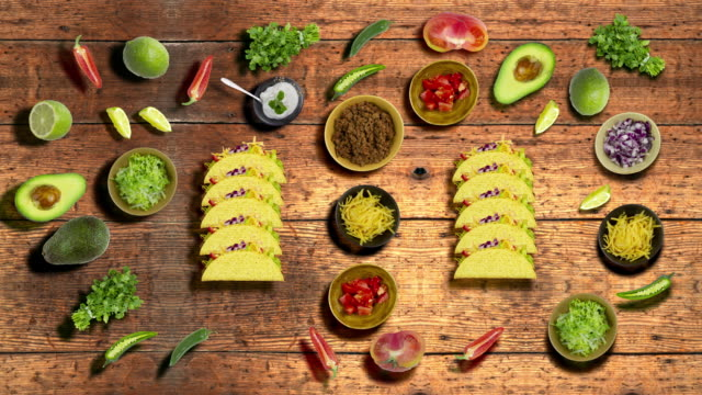 Tacos on a wood table background