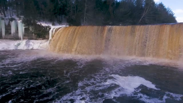 Tahquamenon Falls 4k 4k Aerial footage of the water flowing over Tahquamenon Falls in Mmichigans Upper Peninsula. hd format stock videos & royalty-free footage