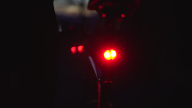 Tail light of a bicycle with cyclist about to embark