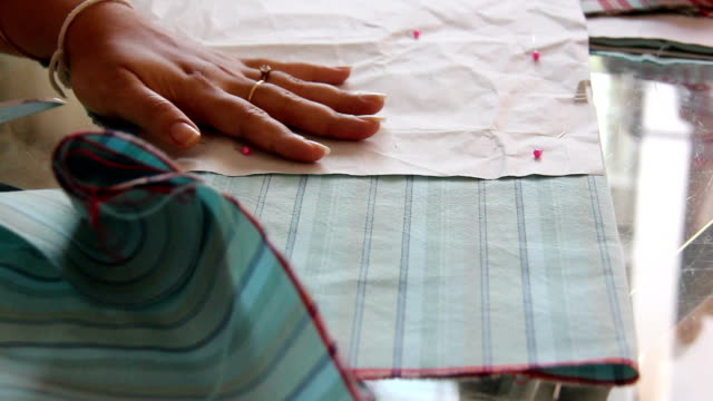 tailor cutting cloth video