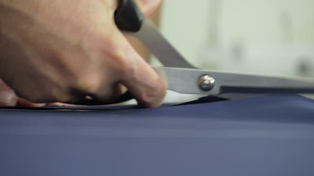 schneider-schneidstoff - menschliche tätigkeit stock-videos und b-roll-filmmaterial