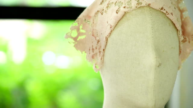 Tailor decorate dress and lace on mannequin video