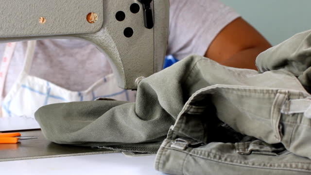 Tailor repairing clothes video