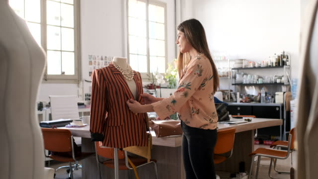 tailor woman working in a small business office, design and fashion industry. - sarta video stock e b–roll