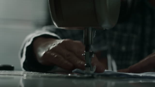 Tailor working on sewing machine video