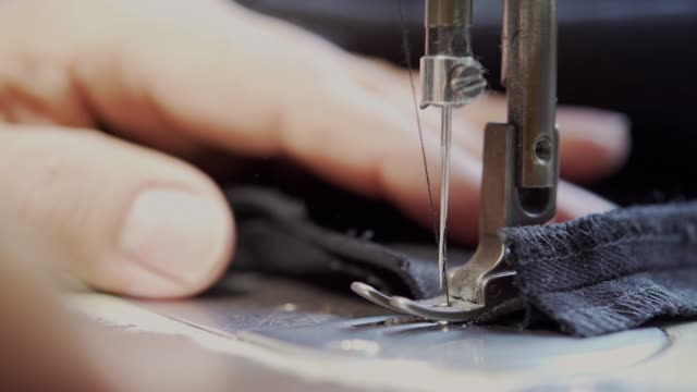 tailor working with sewing machine - macchina per cucire video stock e b–roll
