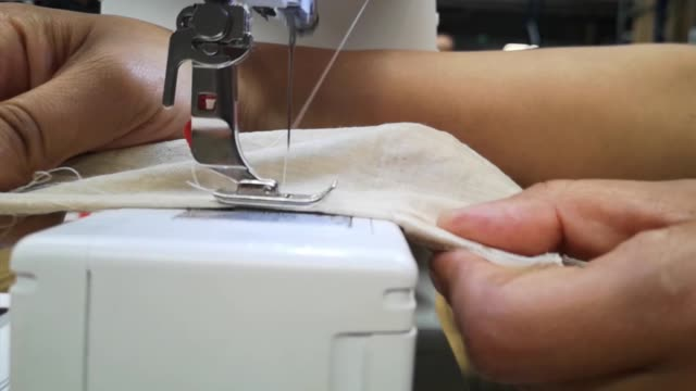 tailor works with sewing machine - macchina per cucire video stock e b–roll
