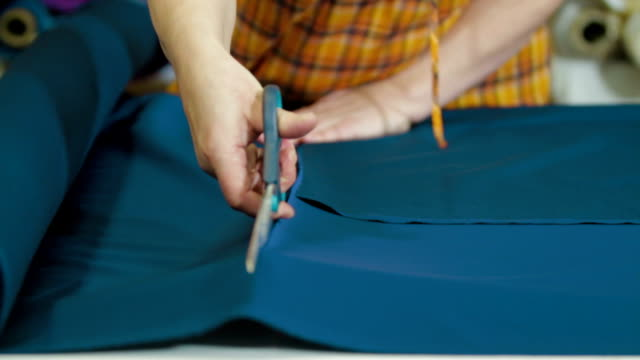 Tailors cutting supplies for sewing shirt video