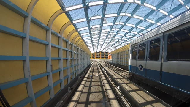 Taipei elevated Rail Metro System An elevated train, journey on the modern driverless Taiwan elevated Rail Metro System, running alongside the Taipei city. Railway crossing-Dan tramway videos stock videos & royalty-free footage
