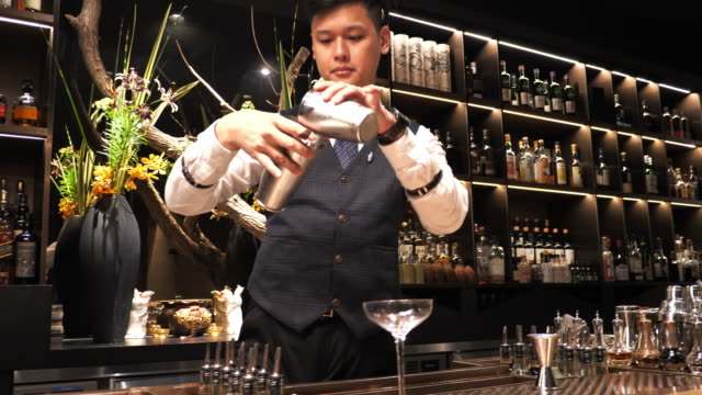 Taiwanese cocktail master shaking cocktail for the party.