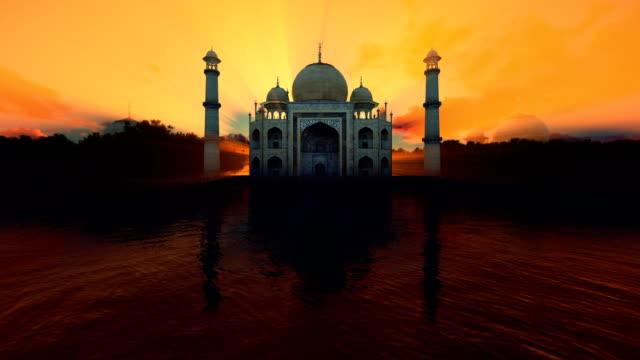 taj mahal framifrån mot vacker sol i gryningen, 4k - moské bildbanksvideor och videomaterial från bakom kulisserna