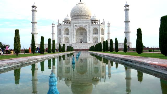 Taj Mahal monument reflecting in water of the pool, Agra, India