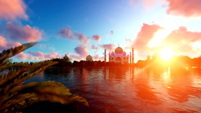 taj mahal, view from yamuna river, aircraft passing against beautiful sunrise - india video stock e b–roll