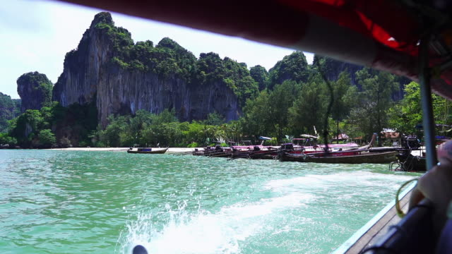 take a long tail boat to railay beach - sky diving video stock e b–roll