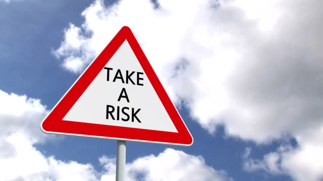 Take a risk sign against blue sky video