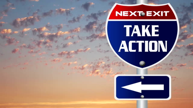 Take action road sign with time lapse cloud background video