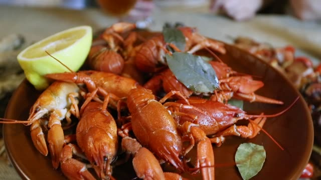 take hand cooked crawfish from the plate video