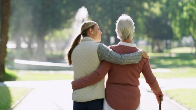 ta dem under din vinge som de gjorde för dig - senior walking bildbanksvideor och videomaterial från bakom kulisserna