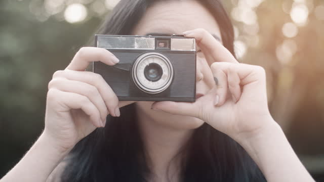 Taking a photo with vintage camera