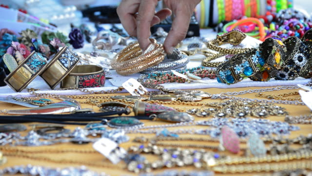 Taking bracelet jewelry exposed in hawker stall craft video