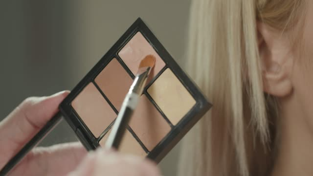 Taking concealer from palette with brush Using make-up brush to make perfect concealer combination from palette foundation make up stock videos & royalty-free footage