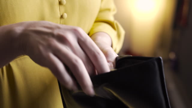 Taking money from wallet Woman taking out USA dollar bills from her purse and count the moneysta money bills and currency stock videos & royalty-free footage