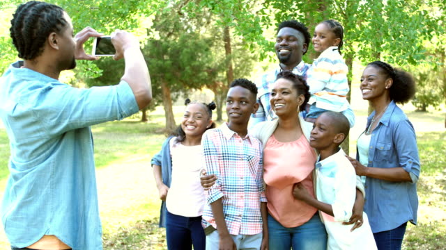 Taking photo of couple, extended family joins them video